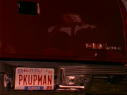 PKUPMAN license plate on the red GMC Pickup from Joe Diffie's music video