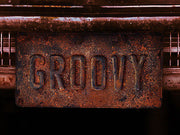 GROOVY license plate on Ash Williams' 1973 Oldsmobile Delta 88 from Ash vs Evil Dead