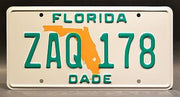 Replica metal stamped Florida license plate garage decor from Miami Vice starring Saundra Santiago