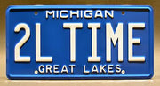 Replica metal stamped Michigan license plate garage decor from Home Improvement with Tim The Tool Man Taylor