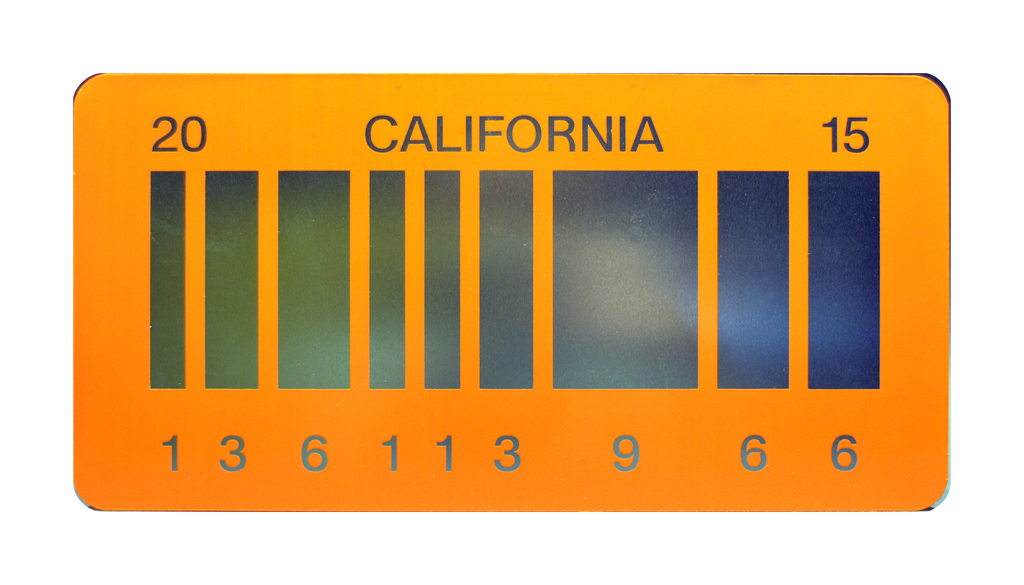 Reflective aluminum bar code prop plate movie memorabilia from Back to the Future 2 starring Michael J. Fox