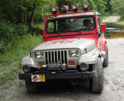 JP 12 license plate on Dennis Nedry's Jeep Wrangler Sahara from Jurassic Park