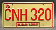 Replica metal stamped Georgia license plate garage decor from Dukes of Hazzard with Boss Hogg