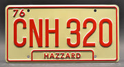 Replica metal stamped Georgia license plate garage decor from Dukes of Hazzard with Flash