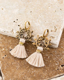 White tassel earrings with vintage floral brass