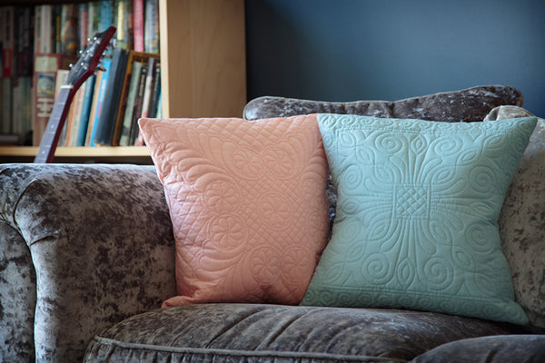 Our Durham and Welsh Wholecloth cushions on a plush sofa