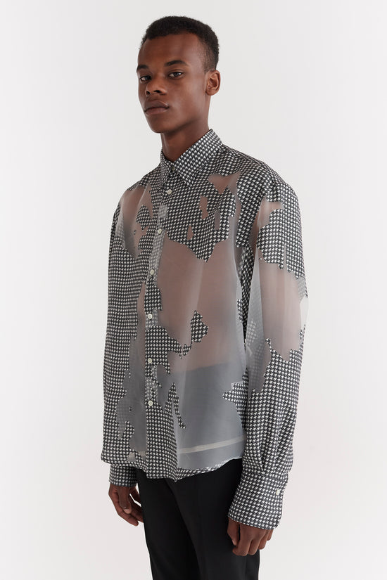 CMMN SWDN AW19 Chase is a relaxed fit drop shoulder shirt. Crafted from viscose fabric, digitally printed, Houndstooth check, handprinted with Devoré effect.