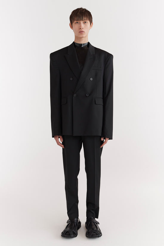 CMMN SWDN AW19 Eli is a double-breasted tailored suit jacket in a boxy fit with extended shoulders and signature concealed zips in the sleeves
