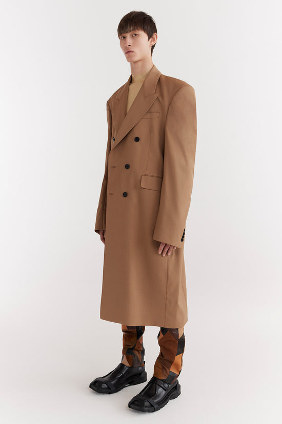 CMMN SWDN AW19 Emil is a double-breasted tailored coat in a boxy fit and extended shoulders and signature concealed zips