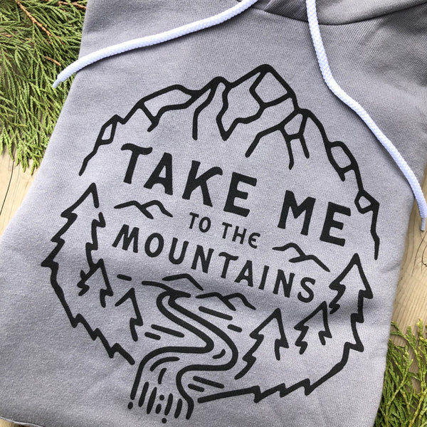 """TAKE ME TO THE MOUNTAINS"" SPONGE FLEECE HOODY"