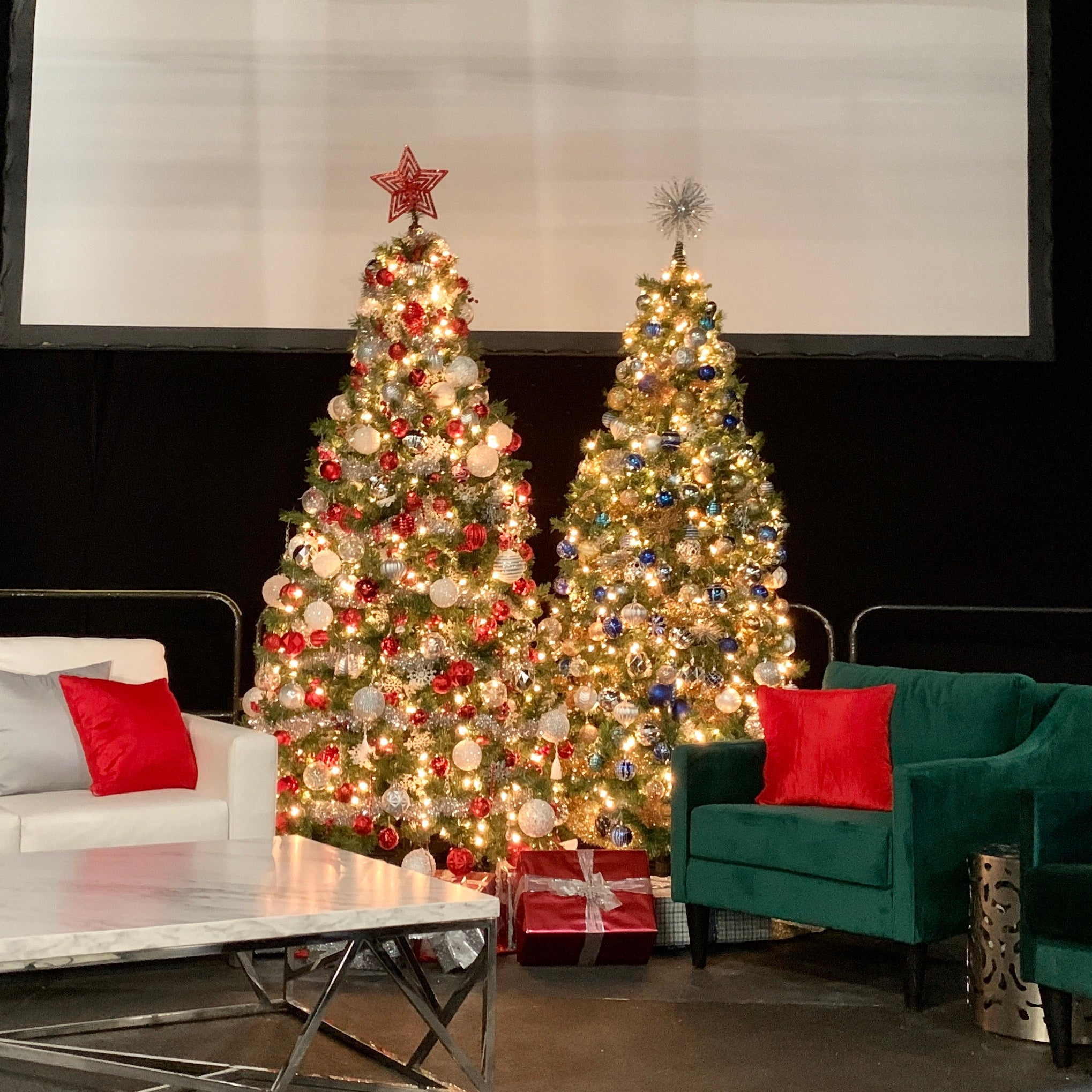 Decorated tree cluster on stage at commercial event