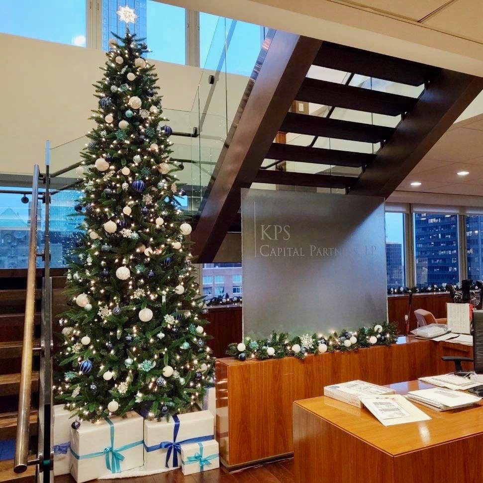 Decorated Christmas tree and hand-wrapped presents in commercial office lobby