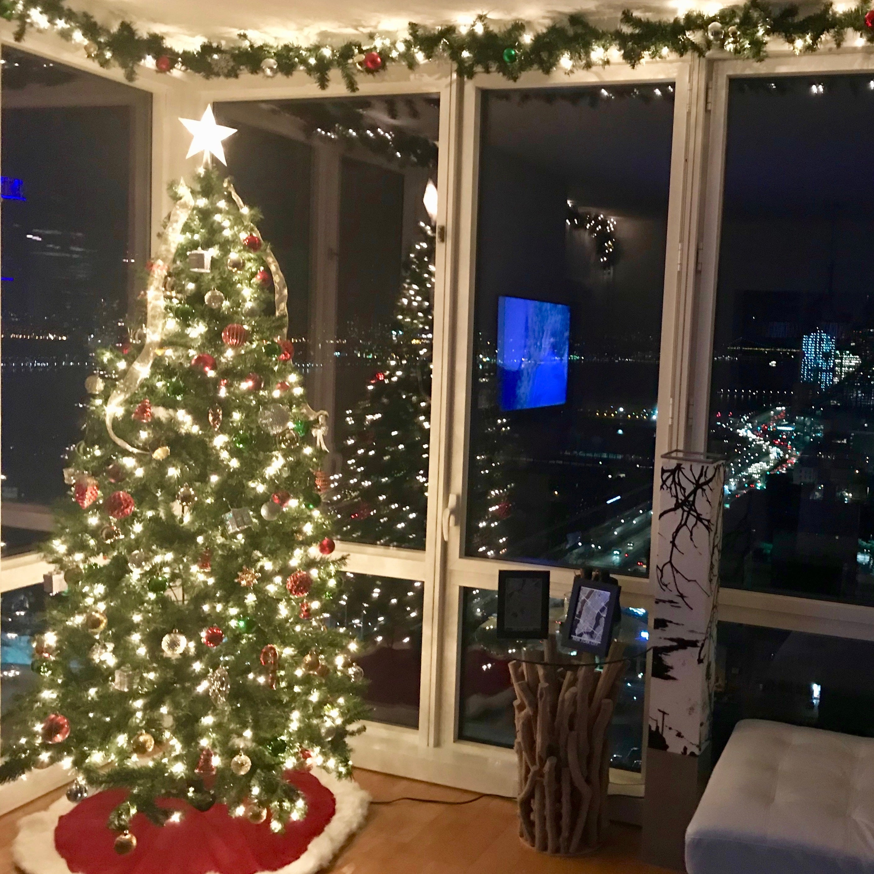 Decorated artificial Christmas tree and garland in residential living room