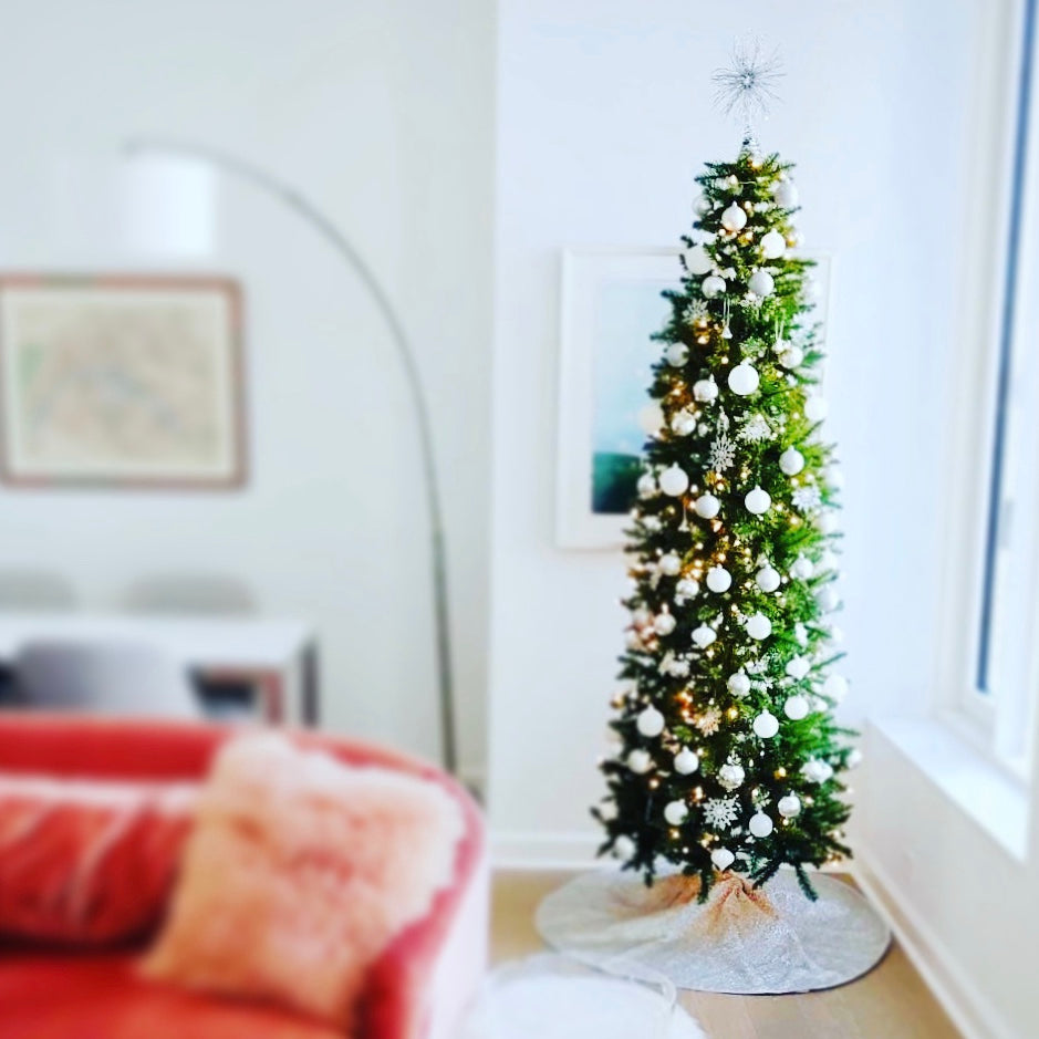 Decorated artificial Christmas tree in residential living room