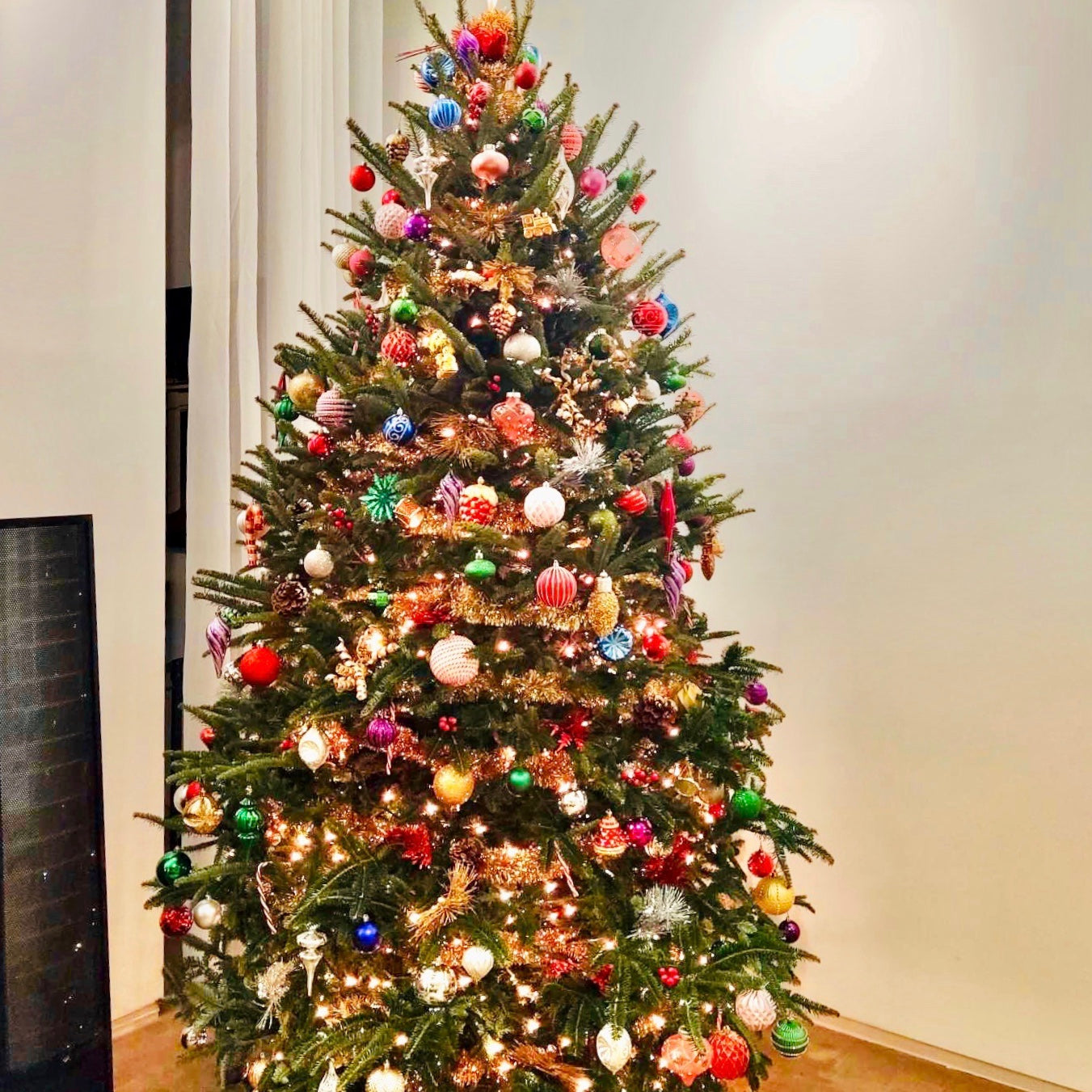 Decorated fresh-cut Fraiser Fir Christmas tree in residential living room