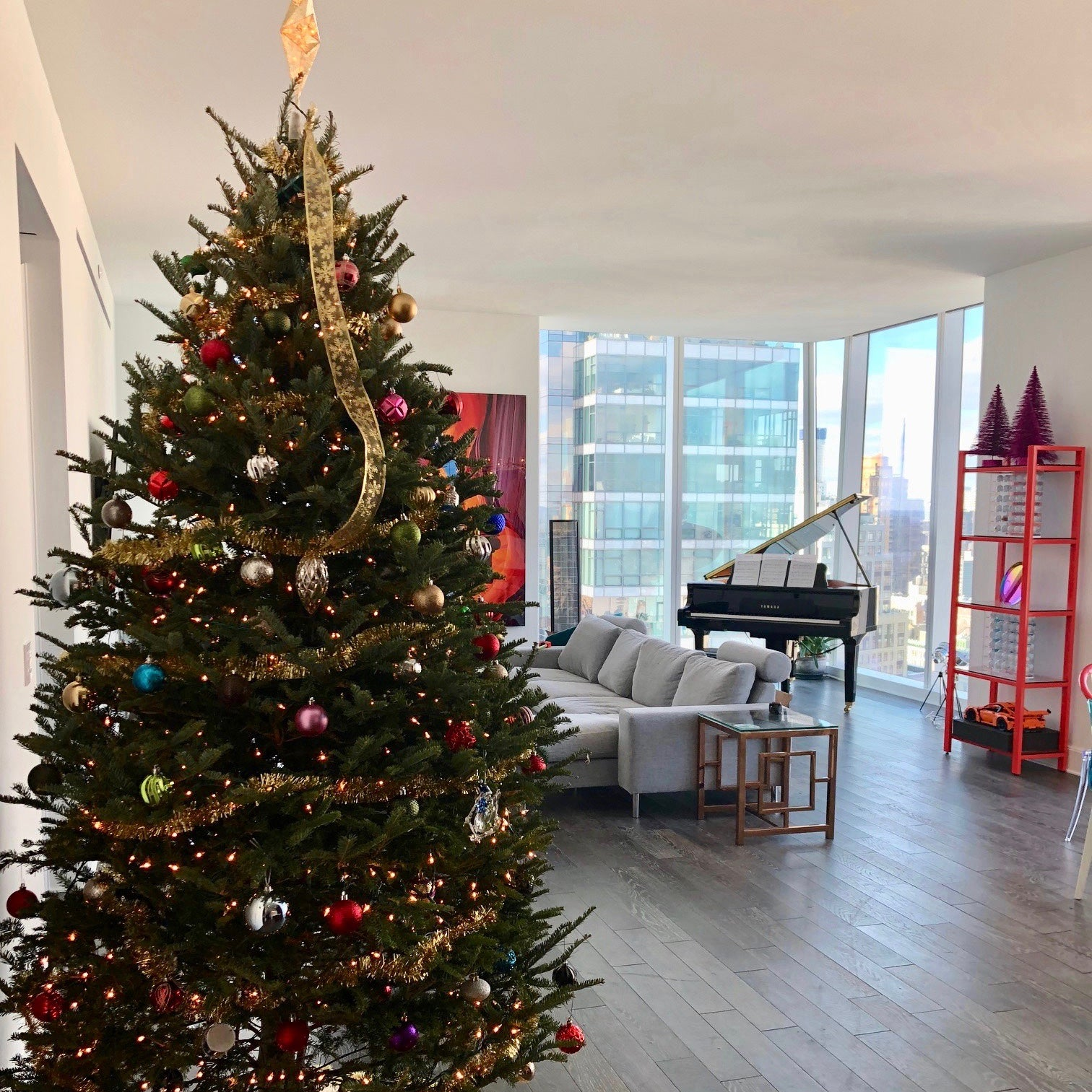 Decorated fresh-cut Frasier Fir Christmas tree in residential living room