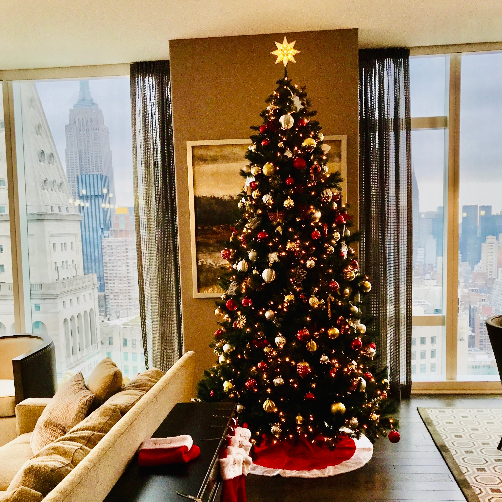 Decorated artificial Christmas tree in residential room