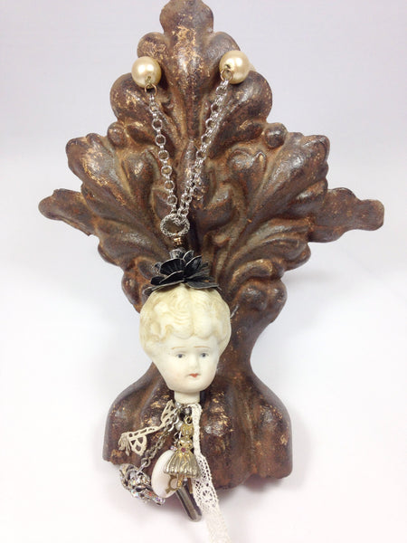 Miss Marple Goes to Town; Doll head necklace