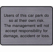 Engraved Users of this car park do so at their own risk sign