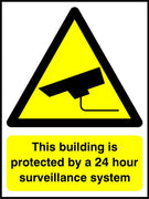This building is protected by a 24 hour surveillance system sign