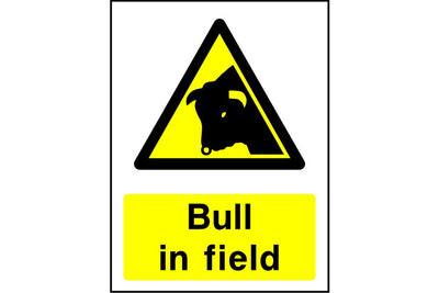 Bull in field warning sign