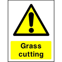 Grass cutting caution sign