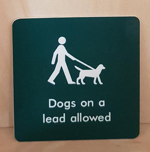 Engraved dogs on a lead allowed sign