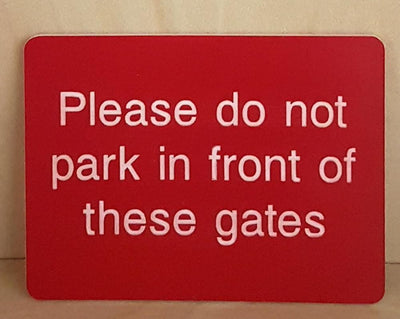 do not park in front of these gates sign