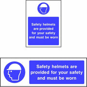 Safety helmets are provided for your safety and must be worn sign