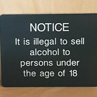 Engraved illegal to sell alchol to under 18s sign