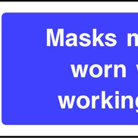 Mask must be worn when working here sign