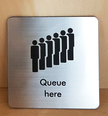 Engraved queue here sign