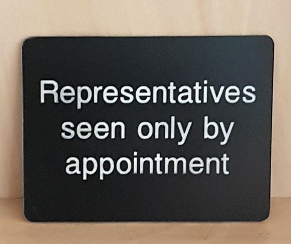 Engraved representatives seen only by appointment sign