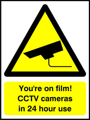 You're on film! CCTV cameras in 24 hour use sign