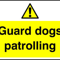 Guard dogs patrolling sign