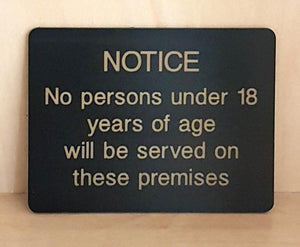 Engraved no persons under 19 will be served sign