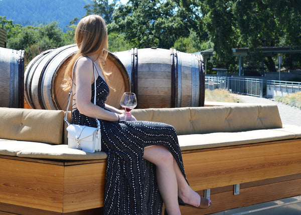Best places to visit in Sonoma, girl sitting on wine barrels at williams selyum