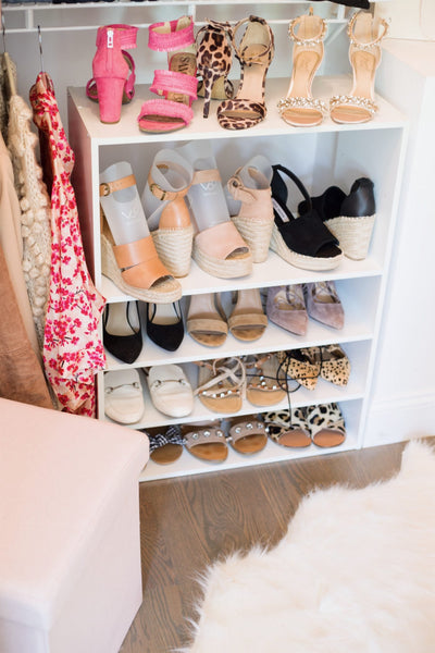Shoes organized in closet with boot shapers