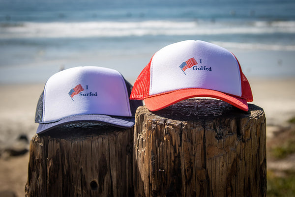 I Surfed I Dolfed Trucker hats at the beach