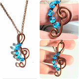 I Love the Blues Treble Cleft Blue Heart Pendant Necklace, Five Tiny Aqua Blue Glass Hearts and an Antique Copper Treble Cleft Pendant on chain.