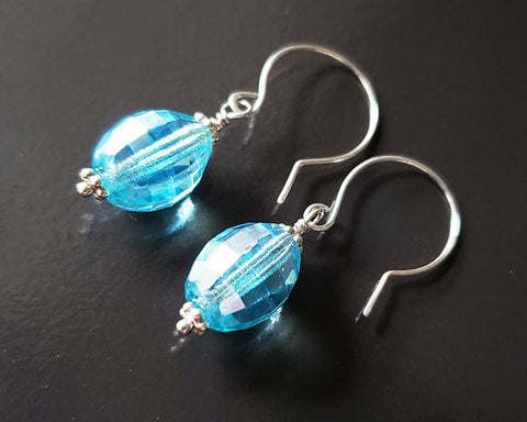 Brilliant Aqua Blue Crystal Drop Earrings made with solid Sterling Silver and sparkly oval shaped faceted aqua blue Vintage Crystal