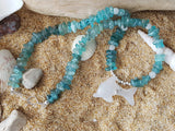 Dolphin Joy Apatite Beaded Necklace, Made with a Caved White Quartz Dolphin, Moonstone and Apatite Stone beads. Sterling Silver, Wire Wrapped, Handmade, hammered hook clasp.