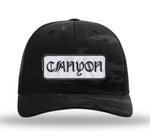 Curved bill Trucker with Canyon script patch dark camo