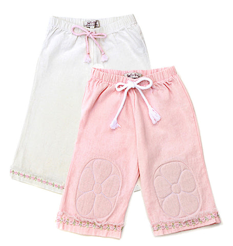 For infant girls who are ready to explore, these organic linen capri style pants are perfect to protect those tender knees in warmer climates. Soft pastel pink and ivory colors, with quilt stitch flower padded knee design. Elastic waist with decorative cotton cord drawstring. Complete the look with the organic linen baby doll top.
