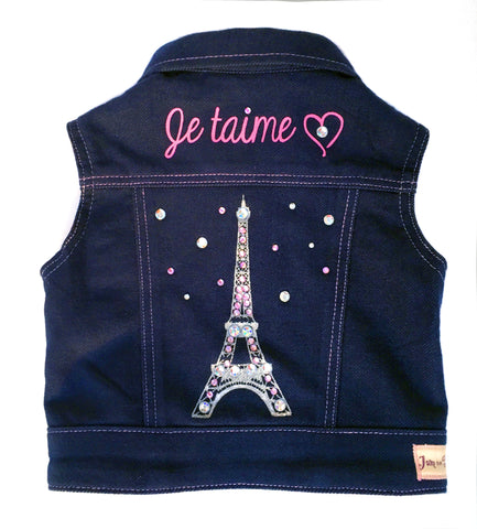 Paris Je t'aime, (Paris I Love You) Denim Vest. Your little princess will be the talk of the playground in this soft denim knit vest, with Eiffel Tower screen print design and rhinestone detailing. Lined with 100% cotton, striped knit. Contrast stitching and silver snap closures.
