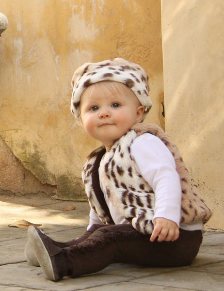 Your winter princess will be warm and cozy in our plush snow leopard cuddle vests