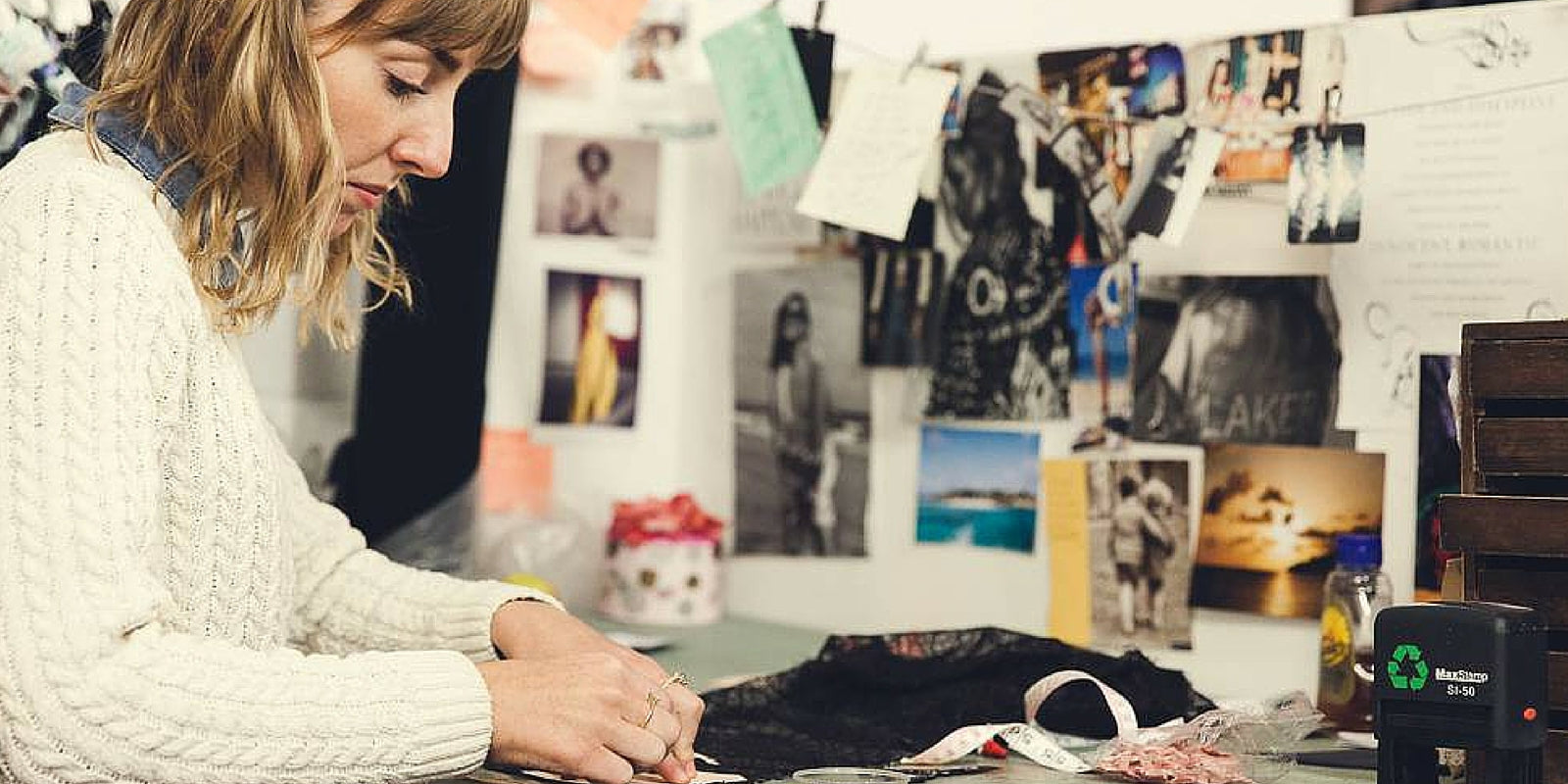 Ellie Simpson-Gray of Iris London sewing in her studio