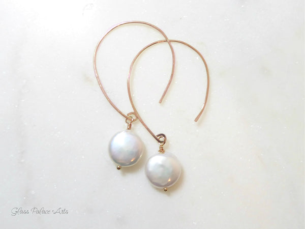 Solid hammered brass disc earrings with freshwater coin pearls.