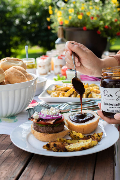 Add some bbq sauce to your ultimate backyard bbq burger. Get great sauces and dips from Pear & Simple gift shop in Port Washington, Wisconsin.