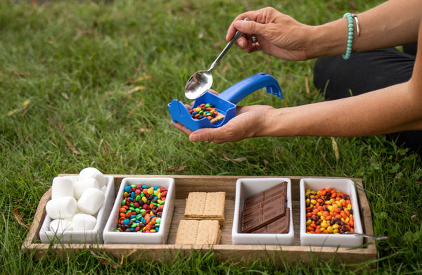 Loading ingredients into the smore builder, which you can purchase from Pear & Simple in Port Washington, Wisconsin